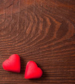 Red hearts on wooden background — ストック写真