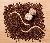 Coffee beans and macaroons — Stock Photo
