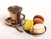 Coffee and macaroons — Stock Photo