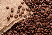 Coffee beans and burlap — Stock Photo