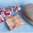 Spa stones, soap and pink orchid — Stock Photo #49955183