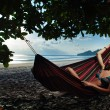 Pretty woman is laying on the hammock — Stock Photo