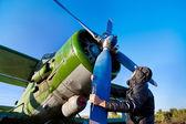 Pilot is repairing engine — Stock Photo