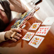 Serious gentleman open his cards in poker — Stock Photo