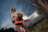 Maniac with the chainsaw — Stock Photo