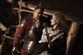 Medieval peasant woman is flirting with the knight — Stock Photo