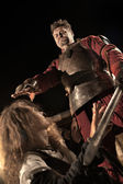 Medieval knight is going to make an execution of a witch — Stock Photo
