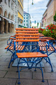 Wet chairs on morning street — Stock Photo