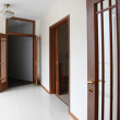 Empty corridor with wooden doors — Stock Photo