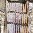 Old locked window with lattice in vintage wall — Stock Photo