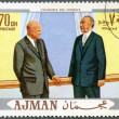 Stockfoto: AJMAN - 1970: shows President Dwight D. Eisenhower (1890-1969) and Konrad Hermann Joseph Adenauer (1876-1967)