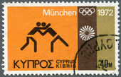 CYPRUS - 1972: shows Wrestling, Olympic and Motion Emblems — 图库照片