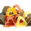 Heart-shaped colored Italian pasta — Stock Photo