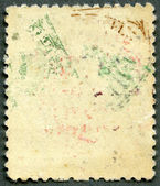 The reverse side of a postage stamp — Stock Photo