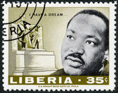 LIBERIA - 1968: shows Martin Luther King Jr. (1929 - 1968) and Lincoln monument by Daniel Chester French — Stock Photo