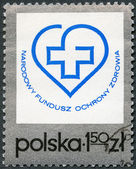 POLAND - 1975: shows Health Fund Emblem — Stock Photo