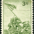 USA - 1945 : shows Marines Raising the Flag on Mount Suribachi, Iwo Jima, from a Photograph by Joel Rosenthal, Achievements of the U.S. Marines in WWII - Stock Photo