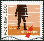 PORTUGAL - 1977: shows Alcoholic and Bottle, symbolic figure of broken life — Stock Photo