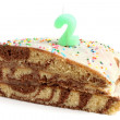 Slice of birthday cake with number two candle — Stock Photo #15777953