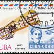 Royalty-Free Stock Photo: CUBA - 1977: shows Biplane and old post stamp with portrait Agustin Parla, series International Airmail Service, 50th Anniversary