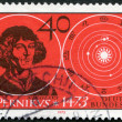 Stock Photo: GERMANY - 1973: shows astronomer Nicolaus Copernicus (1473-1543) and Solar System