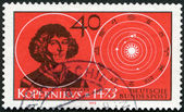 GERMANY - 1973: shows astronomer Nicolaus Copernicus (1473-1543) and Solar System — Stock Photo