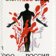 RUSSIA - 1993: shows Stop AIDS! A man's figure in a colorful composition — Stock Photo