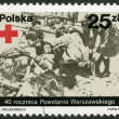 POLAND - 1984: shows wounded Polish partisan of the Armia Krajowa receiving first aid, photo taken by Joachim Joachimczyk, devoted 40th anniversary of Warsaw Uprising — Stock Photo