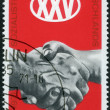 GERMANY- 1971: shows Clasped Hands, 25th anniversary of Socialis — Zdjęcie stockowe