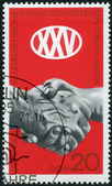 GERMANY- 1971: shows Clasped Hands, 25th anniversary of Socialis — Stockfoto