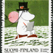 FINLAND - 1998: shows Moomin Cartoon Characters, by Tove Jansson: Boy Moomin drawing with pad and pencil - Stock Photo