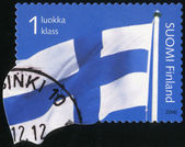 FINLAND - 2006: shows flag of Finland — Foto de Stock