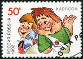 Rusia - 1992: muestra el niño y carlson, personajes de la serie de libros infantiles — Foto de Stock