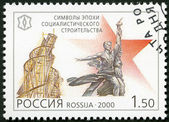 "RUSSIA - 2000: shows ""A Workman and a Collective Farmer"" by V.I. Mukhina and monument to the Third International, Symbols of socialism, series National Cultural Milestones in the 20th Century — Stock Photo"