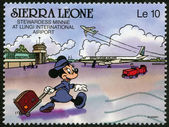 SIERRA LEONE - 1990: shows stewardess Minnie Mouse at Lungi International Airport, Walt Disney Characters — Stock Photo