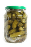 Pickled cucumbers in glass jar — Stock Photo