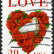 "Stock Photo: USA - 1994: shows word ""love"" and dove in a love heart made of roses"