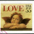 "USA - 1995: shows word ""love"" and Cherub from Sistine Madonna, by Raphael - Stock Photo"