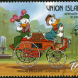 Stock Photo: ST. VINCENT GRENADINES - UNION ISLAND - 1989: shows Donald Duck and Daisy Duck, 1890-1891 Panhard-Levassor, series Disney characters in various French vehicles