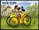 ST. VINCENT GRENADINES - UNION ISLAND - 1989: shows Mickey Mouse and Minnie Mouse, 1893 Peugeot, series Disney characters in various French vehicles — Foto de Stock