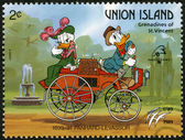 ST. VINCENT GRENADINES - UNION ISLAND - 1989: shows Donald Duck and Daisy Duck, 1890-1891 Panhard-Levassor, series Disney characters in various French vehicles — Stock Photo