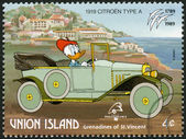 ST. VINCENT GRENADINES - UNION ISLAND - 1989: shows Donald Duck, 1919 Citroen, series Disney characters in various French vehicles — Stock Photo