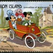 ST. VINCENT GRENADINES - UNION ISLAND - 1989: shows Mickey Mouse, Minnie Mouse, and Daisy Duck, 1891 De Dion Bouton Quadricycle, series Disney characters in various French vehicles — Stock Photo