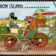 ST. VINCENT GRENADINES - UNION ISLAND - 1989: shows Mickey Mouse and Minnie Mouse, 1878 La Mancelle, series Disney characters in various French vehicles — Stock Photo #21783719