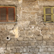 Old locked windows in vintage wall — Stock Photo