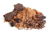 Cacao beans, cacao powder and chocolate — Stock Photo