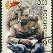 Stock Photo: RUSSI- 2005: shows at intervals between battles, Kalininsky Front, 1943 (sitting soldier), 60th anniversary of Victory in Great Patriotic War of 1941-1945