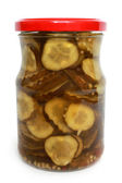 Pickled cucumbers in glass jar — Стоковое фото