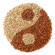 Green and fried buckwheat forming a yin yang symbol — Stock Photo