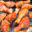 Marinated chicken legs on the grill — Stock Photo
